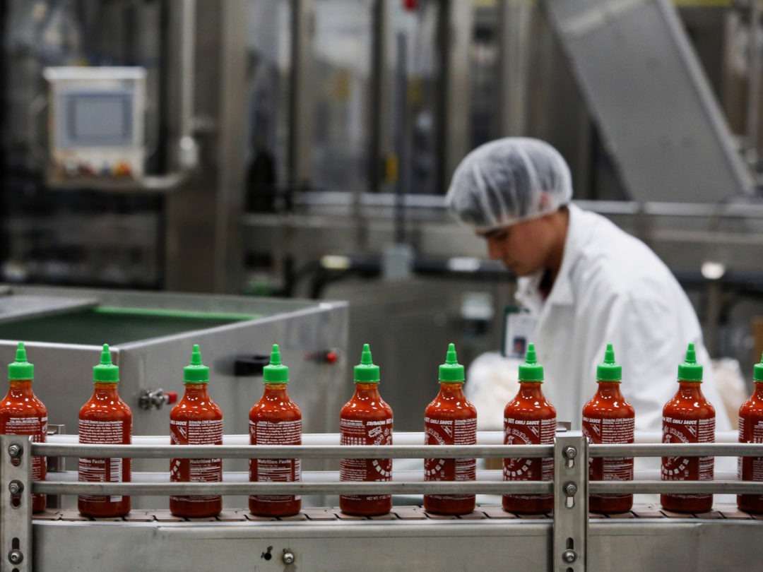 Two Hot-Sauce Fortunes 8,000 Miles Apart Are Poised to Collide
